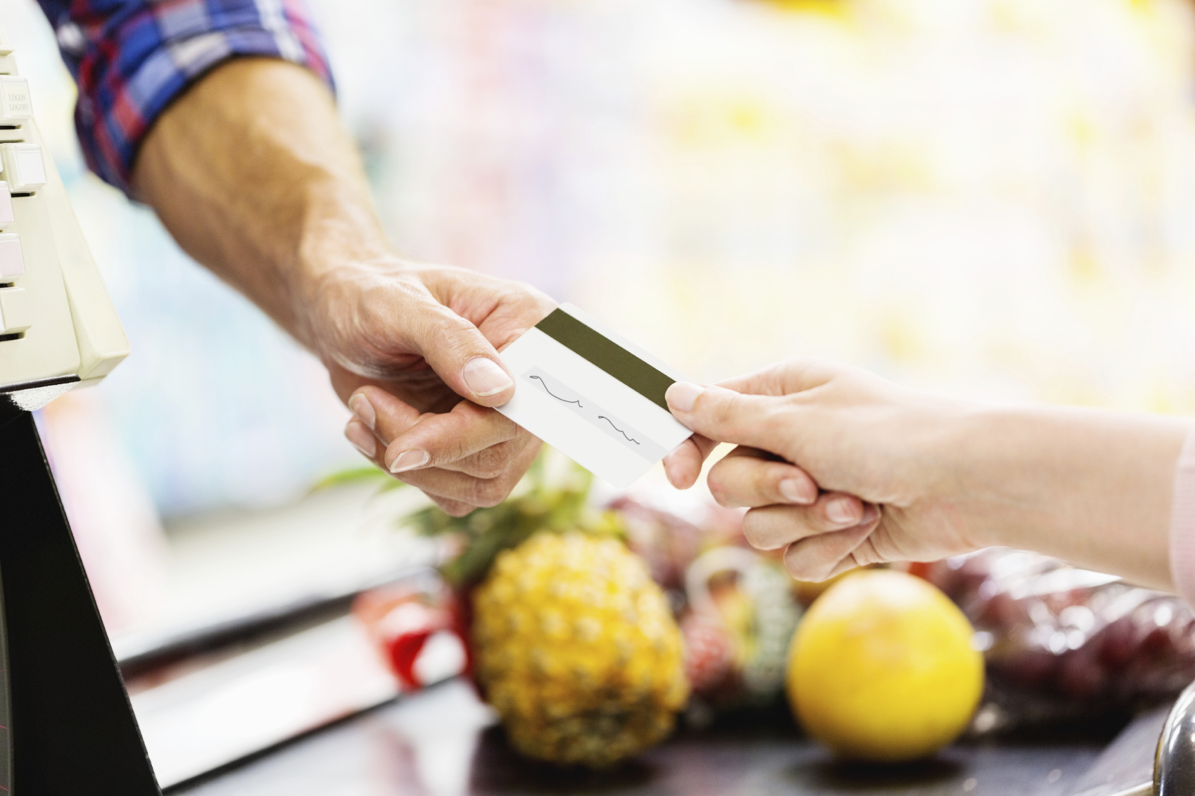 Ananas Credit clerk's hand receiving credit card from man at counter | the engage blog