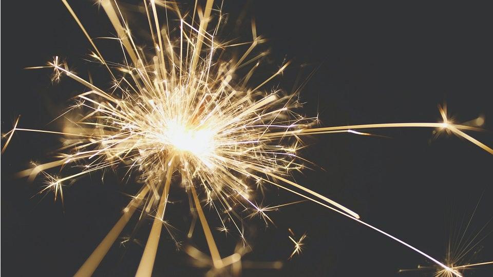 Image of sparkler on dark background